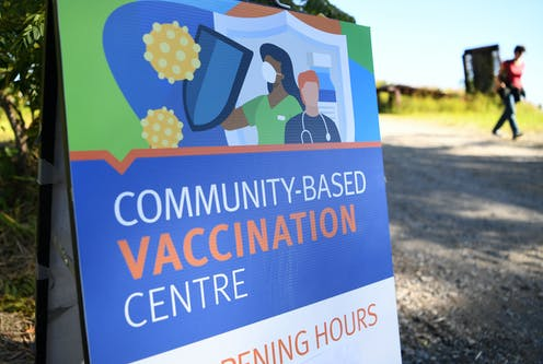 Sign for community vaccination centre