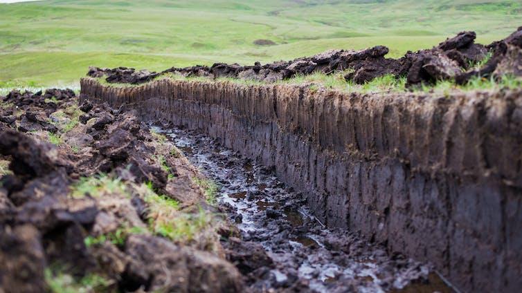 A ditch dug in a peat bog.