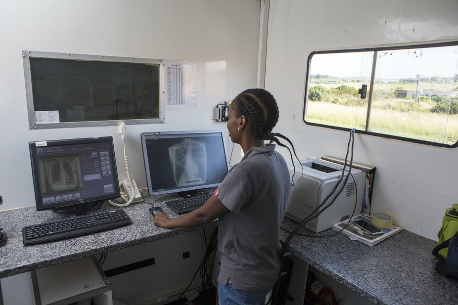health worker looking at X-rays