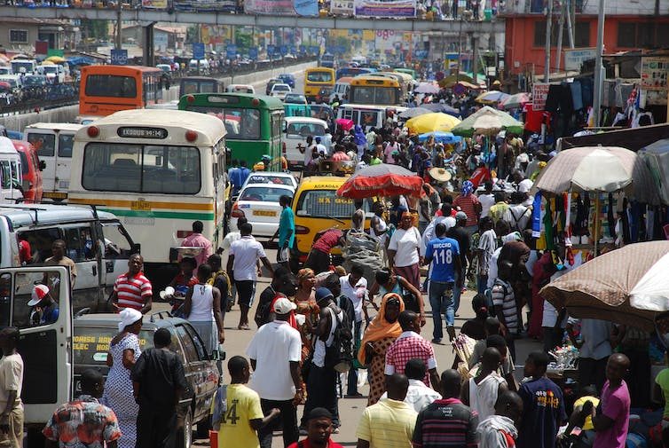 A crowded street with cars in Ghana