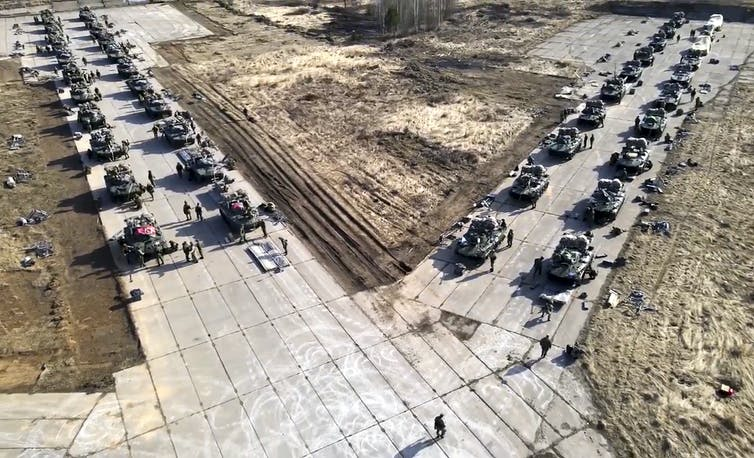Russian military vehicles lined up on the road for military drills.