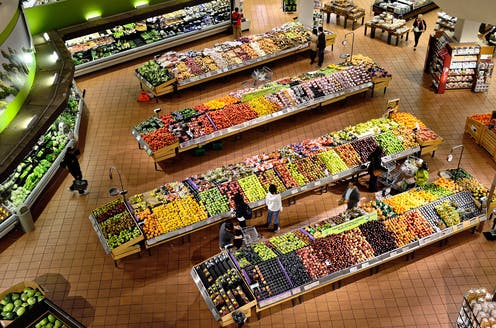 People shopping at a grocery store, shot from above