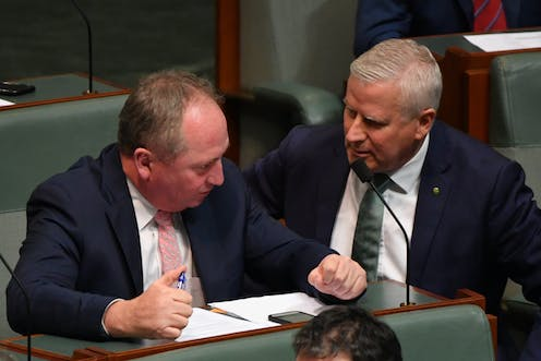 Barnaby Joyce speaks to Michael McCormack in parliament in May 2021.