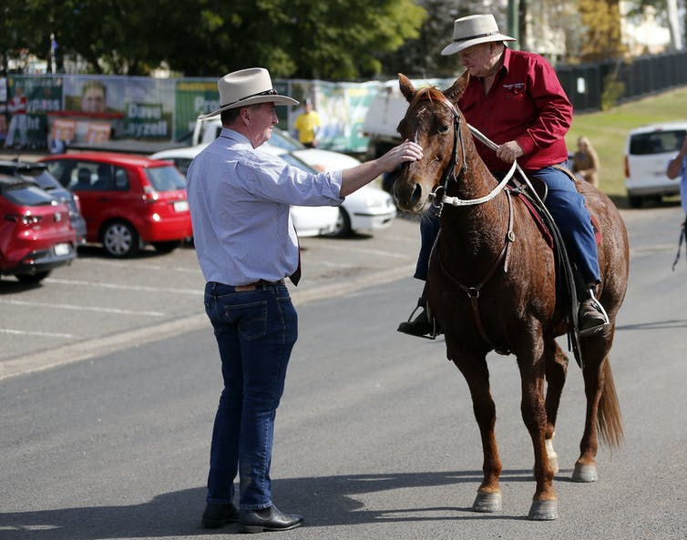 Barnaby Joyce talks to a man on a horse during the Upper Hunter byelection in May 2021.