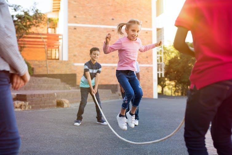 Kids skipping rope at school.