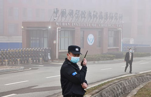 A security guard outside the front entrance of the Wuhan Institute of Virology