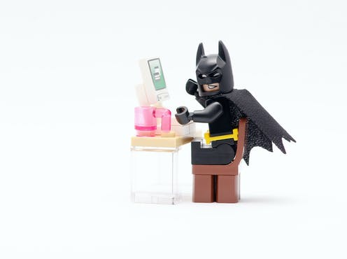 LEGO batman in front of a computer