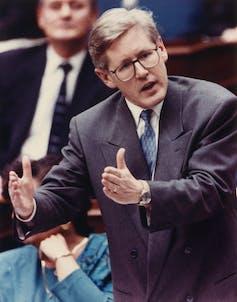 Bob Rae gestures in the Ontario legislature.