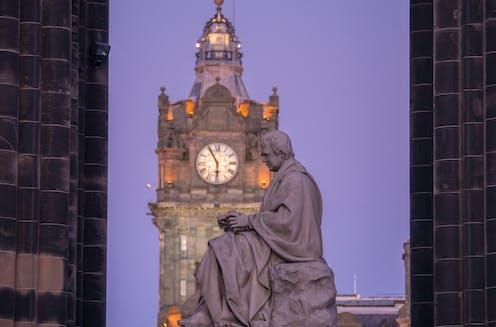 Statue of Walter Scott beneath the Scott Monument on Princes Street Edinburgh.