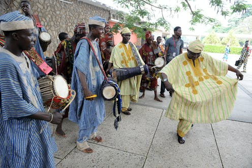 A man dances while others are playing traditional drums during a festival at the University of Ibadan, Oyo State, Nigeria on June 27, 2011.