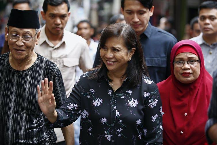 Vice-president of the Philippines, Leni Robredo, smiles and waves at supporters while visiting Quezon City, east of Manila, 2019.