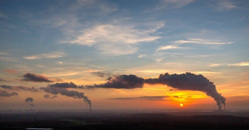 Industrial emissions at sunset