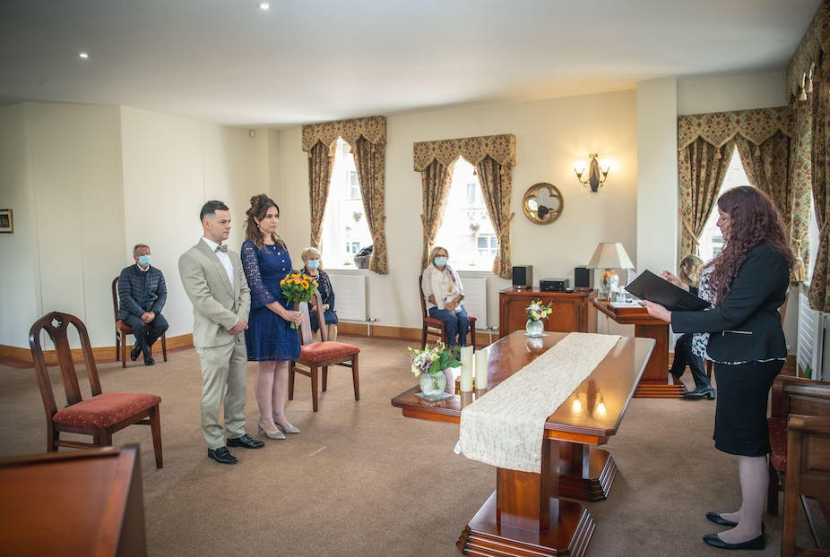 Couple getting married in register office in socially distanced ceremony due to COVID-19