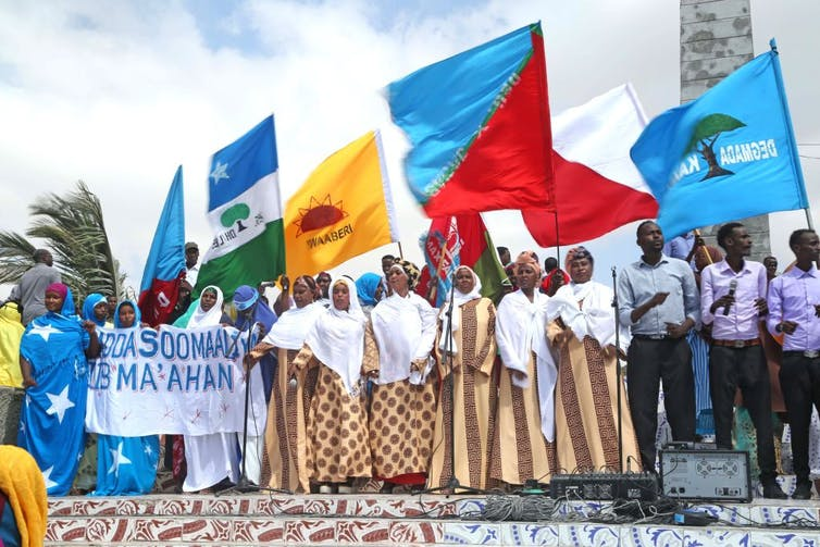 Protesters wave banners in Mogadishu
