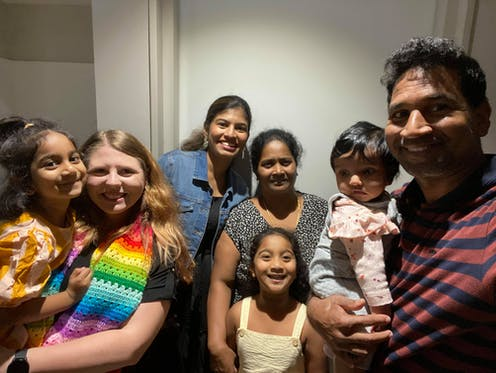 Family of four from Biloela Priya, Nades, Kopika and Tharni Murugappan with family friends and supporters