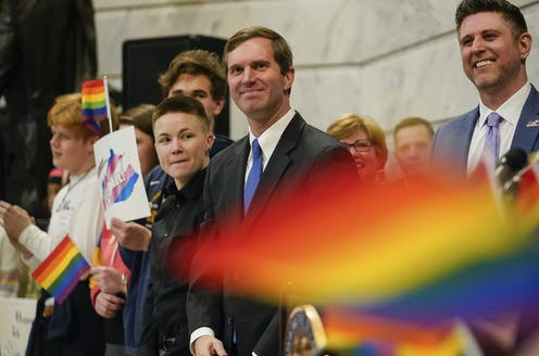 Kentucky Democratic Governor Andy Beshear attends a rally held by LGBTQ rights activists.