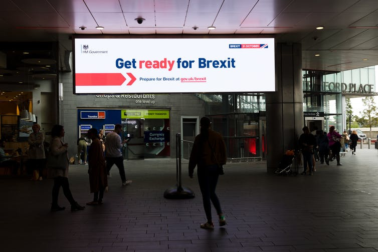 A 'Get ready for Brexit' advertisement glows on a billboard in a UK shopping centre