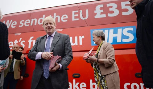"""Boris Johnson standing in front of the """"Vote Leave"""" campaign bus, which claims the UK sends 350 million pounds weekly to the EU, which could be used to fund the NHS."""