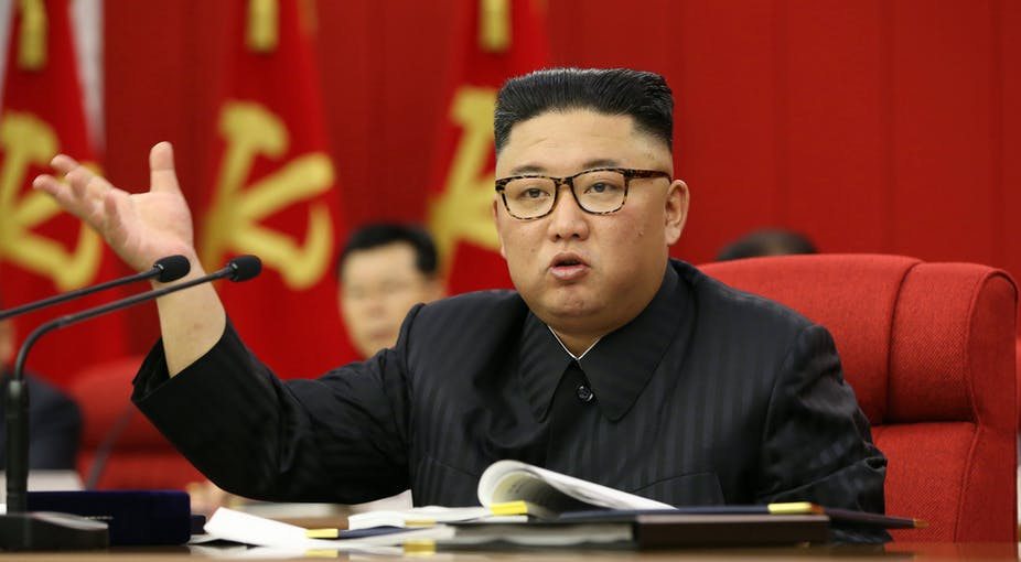 North Korean leader Kim Jong-un presiding over the opening of the third Plenary Meeting of the 8th Central Committee of the Workers' Party of Korea