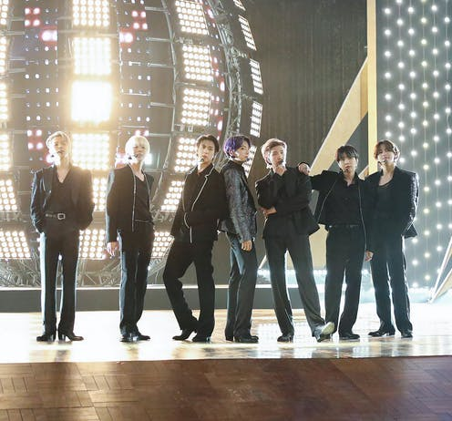 Members of BTS perform onstage