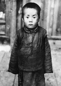 The future Dalai Lama of Tibetan Buddhism, Lhamo Dhondrub, who was later renamed Tenzin Gyatso.