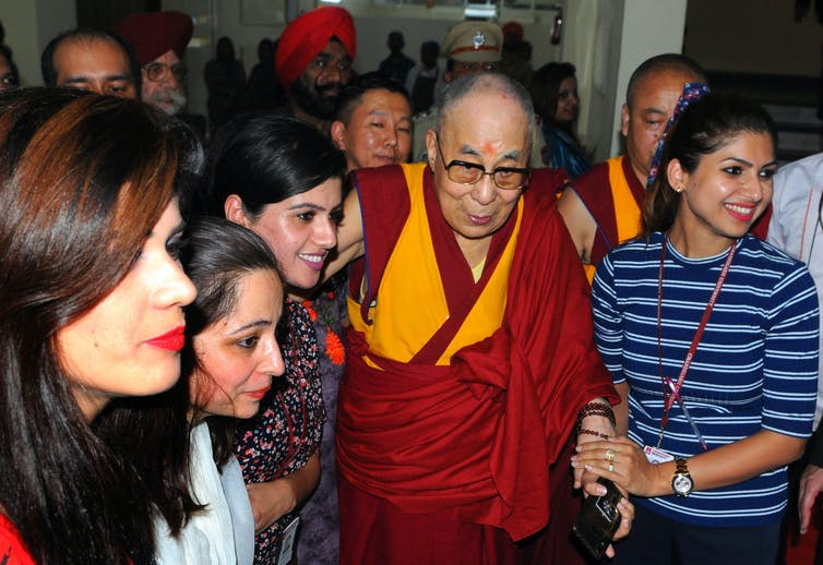 Students interact with the Dalai Lama during a visit to Chandigarh University at Mohali, in northern India.