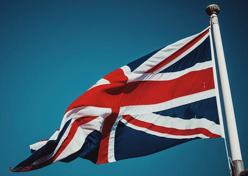 A Union Flag flying in the wind