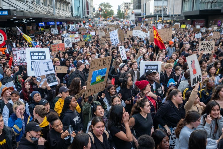 People listening to speeches at a Black Lives Matter rally in Auckland