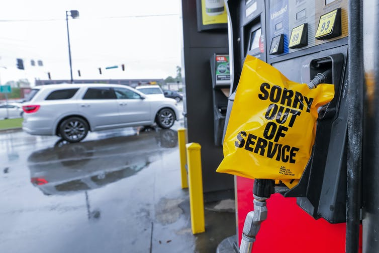 Fuel pump with sign saying 'Sorry Out Of Service'