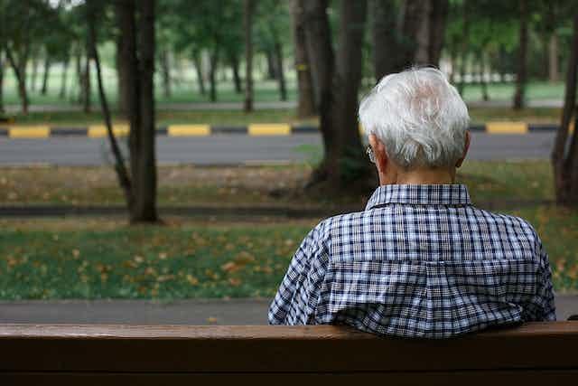 Older man sitting on a park bench