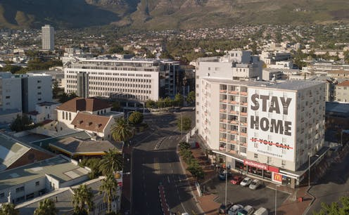 Cape Town during lockdown, with a sign on a building saying 'Stay Home'