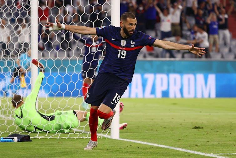 A footballer celebrates a goal.