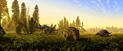 A prehistoric landscape with dinosaurs
