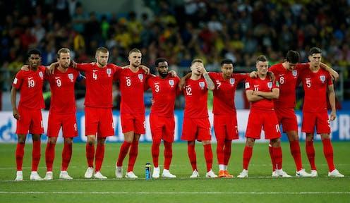 England team watching penalty shootout.