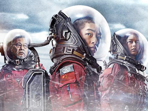 Three astronauts.