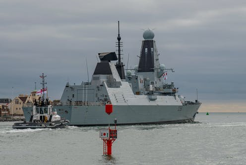 Royal Navy Type 45 destroyer HMS Defender (D36) departing Portsmouth Harbour, UK on October 8 2018