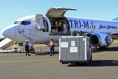 A shipment of COVID-19 vaccines being unloaded from a plane