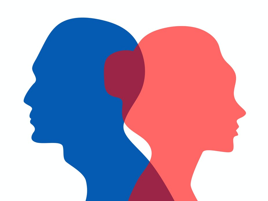 Silhouette of a man and a woman going in opposite directions.