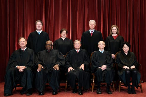 Supreme Court Justices pose during a group photo of the Justices at the Supreme Court in Washington, DC on April 23, 2021