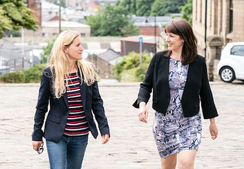 Labour candidate Kim Leadbeater and shadow chancellor Rachel Reeves walking up a hill in the contested seat of Batley in West Yorkshire.