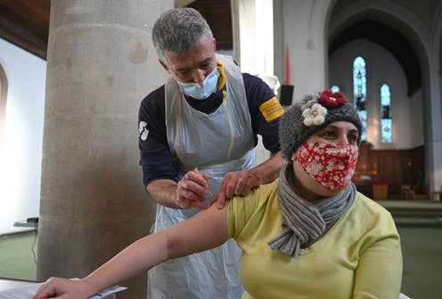 A woman getting vaccinated