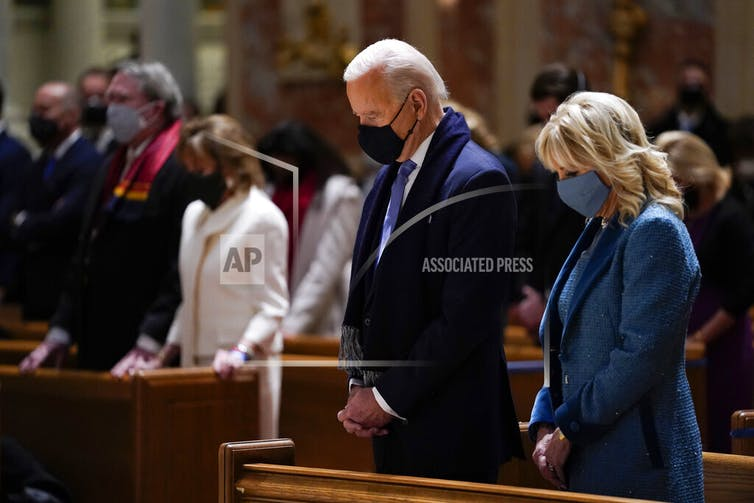 In a Jan. 20, 2021 photo, President-elect Joe Biden and his wife, Jill Biden, attend Mass at the Cathedral of St. Matthew the Apostle during Inauguration Day ceremonies in Washington.