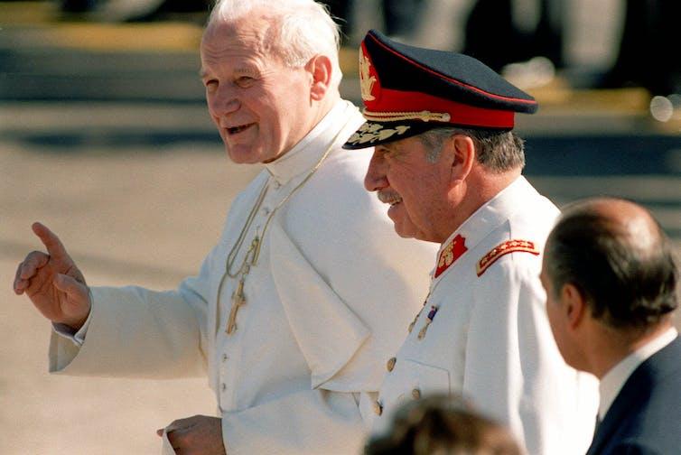 Pope John Paul II, left, with Chilean President Gen. Augusto Pinochet in Santiago, Chile on April 1, 1987.