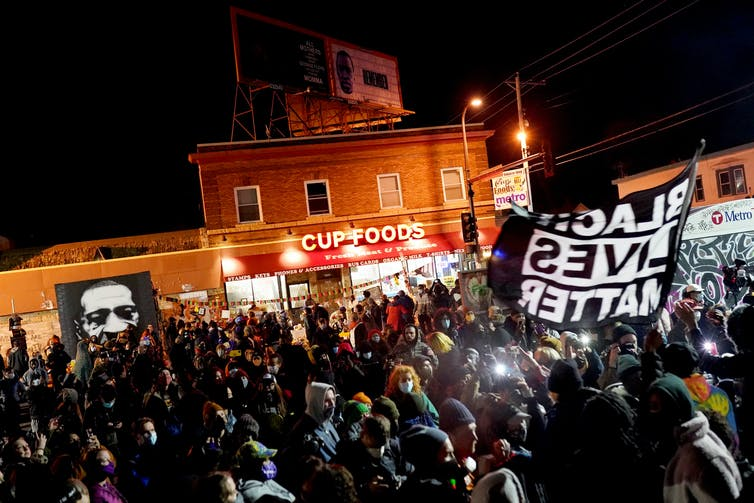A large crowd celebrates the Chauvin verdict outside Cup Foods in Minneapolis, where George Floyd was murdered