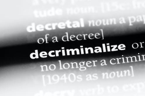 white text on a black background that reads DECRIMINALIZE NO LONGER A CRIMIN