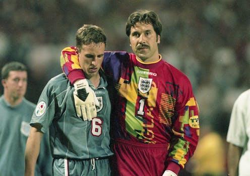 Goalkeeper David Seaman with his arm around Gareth Southgate