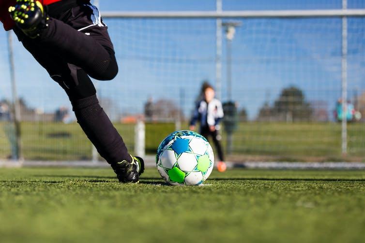 A player taking a penalty kick