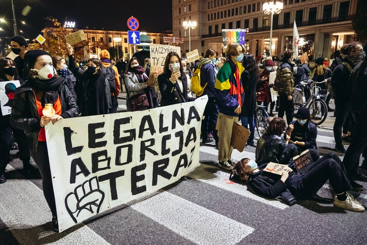 A group of protesters in Warsaw calling for abortion legalisation