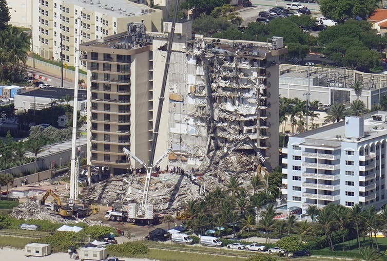 A partially collapsed 12 story apartment building.