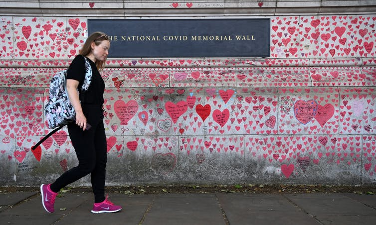 London's COVID-19 Memorial Wall. Britain has recorded more than 128,000 COIVD deaths.